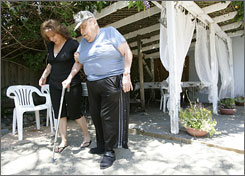 Julie Lucero helps her father Edward Lucero, 79, prior to a family gathering at her sister's house.