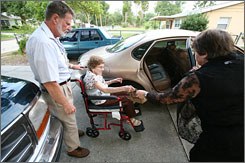 Ralph and Betty Seckinger, right, help his mom, Louise Seckinger, to the car on the way to church.