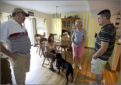 Chatting in the dining room, Bob and Diana Hubka, both 50, share their home with Dianna's mother Dorothy Drinan, 81, and their youngest son, Rob, 22.