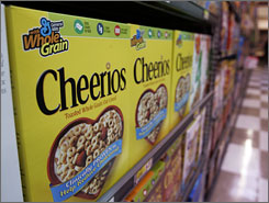 General Mills said Thursday its fourth-quarter profit rose as the company ramped up advertising and set a record of $1 billion in snack sales for the year.