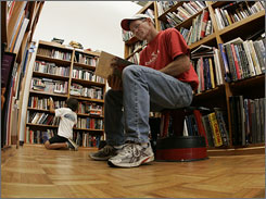 Arend Doppenberg, of Orange, Calif., and his son, Arend Jr., 12, at the Renaissance Book Shop in General Mitchell International Airport in Milwaukee.