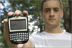 Creighton University economics student Denny Porto, who trades online with Zecco, shows a stock quote on his BlackBerry.