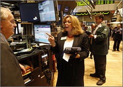 Broker Doreen Mogavero, at the NYSE with James Maguire, says the &quot;old floor of flying paper and screaming traders is gone.&quot;