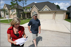 Peter Hudson, a first-time home buyer, checks out a Houston-area neighborhood with real estate agent Tina Kalafut.