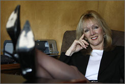 Le Gourmet CEO Cynthia McKay, 5 feet, 9 inches tall, kicks back in her 3-inch heels at her Castle Rock, Colo., office.