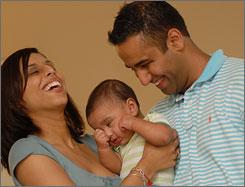 Anita and Raj Nijjer of Scottsdale, Ariz., enjoy a moment with their son, Kabir.