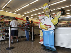 "Homer Simpson is displayed at a Bladensburg, Md., 7-Eleven that's been converted into a Kwik-E-Mart, the convenience store on ""The Simpsons."""