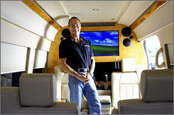 Howard Becker in one of the Dodge Sprinter vans he's customized. The roomy, fuel-thrifty Sprinter is a novelty in the U.S.