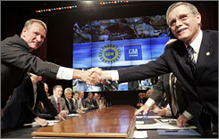 General Motors chief Rick Wagoner, left, and United Auto Workers President Ron Gettelfinger shake hands at the beginning of their talks.