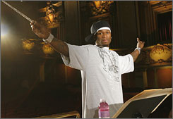 Curtis Jackson, the artist known as 50 Cent, directs an orchestra in an ad for Glaceau.