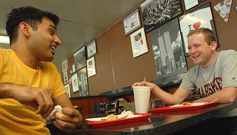 P.J. Gurumohan, left, and Killian McKiernan became good friends as students at Arizona State University and then working together at a patent-licensing office. Friendships can ease the strain of grueling work pressures as the two share lunch at Joe's New York Pizza near their office.