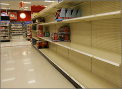 Toy section shelves are near empty after some Fisher-Price products were pulled in a voluntary recall at a Phoenix Target store Thursday.