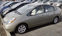 Toyota Prius hybrid sedans on a lot in Boulder, Colo. Carmakers are touting models that produce fewer carbon emissions.