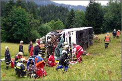The scene of a bus crash in the Tyrol section of Austria in June. At least one was killed and 50 injured in the accident, in which the bus hit a truck and plunged 65 feet down a ravine.