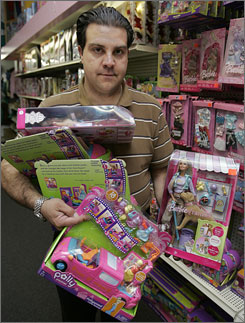 Keith Schumacker collects Polly Pocket Pollywood Limo-Scene and Barbie Tanner sets at Talbots Toyland in San Mateo, Calif., after the recalls.