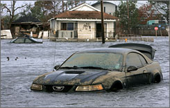 A car sits submerged in New Orleans in 2005 after Hurricane Rita added to flooding caused by Katrina three weeks earlier.
