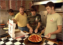 Carl Hixon, second from left, owns Georgio's Pizza in Pensacola, Fla. He wants his sons, from left, Mark, 24, Adam, 18, and Ben, 20, to understand the value of work, even if they have a trust fund.