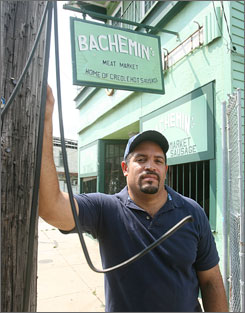  Kevin Bachemin beside the Seventh Ward butcher shop his family has owned for three generations. He's hesitant to reopen it.