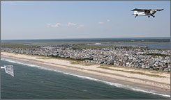 Tow pilot Keith Opelt pulls an advertising banner over beaches at the Jersey Shore. Opelt works for High Exposure in Egg Harbor Township, N.J.