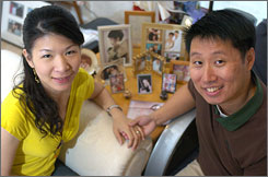 James Chou, with wife Michelle Hung, got a home-equity loan a few years ago to pay off spiraling credit card debt. Now he does a better job controlling his credit spending.