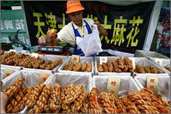 A Chinese vendor sells various foodstuffs at a stall in a market in Shenyang, northeast China's Liaoning province.