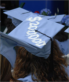 The approximate cost of a four-year education is taped onto the mortar board of a graduate of Barnard College during May 15 commencement ceremonies   in New York.