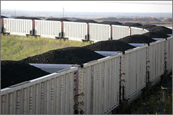 A coal train winds down the track in Venon, Texas. Some freight customers say major railroads are unfairly boosting their rates.
