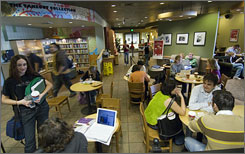 University of South Florida students hang out at a campus library that serves Starbucks coffee.