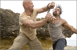 """A supposedly rip-proof page in October's """"Maxim"""" magazine promotes the DVD of """"The Condemned,"""" starring Steve Austin, left, and Manu Bennett."""