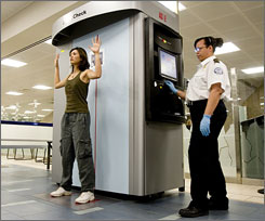 Backscatter X-ray machines, like the one demonstrated here at Sky Harbor airport in Phoenix, are controversial due to their ability to render anatomical images.