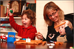 Before going to work at Palo Alto Software where she is CEO, Sabrina Parsons spends some quality time with sons Timmy, 3, left, and Leo, 1, at their home in Eugene, Ore.