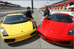 Jonathan Kanter, left, and Jan Otto, co-founders of Supercar Life, with two of their company's vehicles.