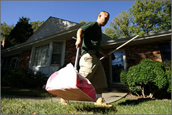 Chris Decastro of DoodyCalls picks up pet excrement in Merrifield, Va. His goal is to buy his own franchise.