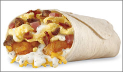 Hardee's Country Breakfast Burrito  two egg omelets filled with bacon, sausage, diced ham, cheddar cheese, hash browns and sausage gravy, all wrapped inside a flour tortilla  sells for $2.69. 