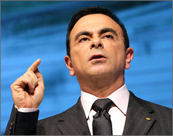 Nissan's Carlos Ghosn talks to reporters Wednesday during the press days of the 40th Tokyo Motor Show.