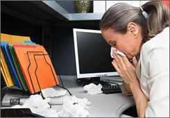 Many employers are beginning to encourage their employees to stay away from the office when they're fighting a cold or flu.