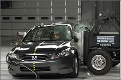 A 2008 Honda Accord is put through a side crash test by the Insurance Institute for Highway Safety.