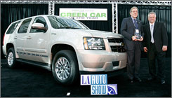 Ron Cogan, right, publisher of Green Car Journal, presents Chevrolets's Jay Flaherty the Green Car of the Year Award for the 2008 Chevrolet Tahoe hybrid.
