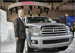 Motoharu Araya, chief engineer for Toyota's Sequoia, poses Wednesday with the latest model of the SUV at the Los Angeles Auto Show.