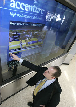Chicago O'Hare and New York's JFK have interactive ad displays that use touch-screen technology from Accenture.