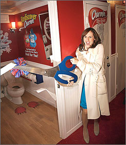 Actor Molly Shannon cuts the ribbon on Procter & Gamble's restrooms in New York City's Times Square.