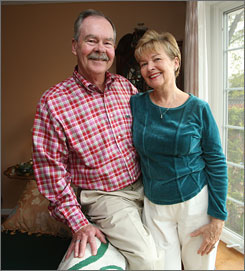 "Doug Breitenbach, with his wife, Maureen, has lost ""on paper"" about $18,000 in his 401(k) fund and is worried about future drops because of the credit crunch and subprime markets."