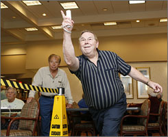 Jim Martin, 67, bowls using a Nintendo Wii at the Henry Ford Village retirement community in Dearborn, Mich., on Nov. 9.