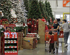 Customers look at holiday merchandise at a Home Depot store in Charlotte in November.