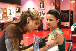 Hannah Atchison, left, works on a tattoo for client Lori Ferguson at High Voltage Tattoo in Los Angeles, featured on the TLC show LA Ink.