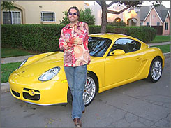 Robert Stacy, CEO of Asia Media Products, and his '07 Porsche Cayman. Execs' car choices give workers a glimpse into the psyche of their bosses.
