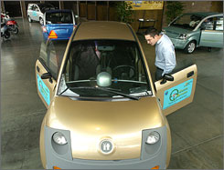 Green Motors in California sells the Zenn and other electric vehicles like the iT, shown here getting a once-over in the dealership's showroom.