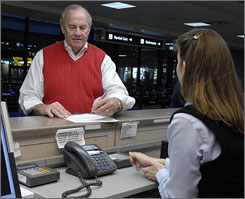 John Wade of Houston declines car rental insurance at a Thrifty kiosk at Tampa International Airport.