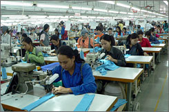 Cambodia's garment industry (here, workers in 2005 in Phnom Penh) is thriving, but for how long?