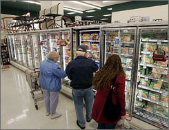 Shoppers browse the frozen foods section at an Acme supermarket in Lawrenceville, N.J. Checking food labels for allergens could take time these days.